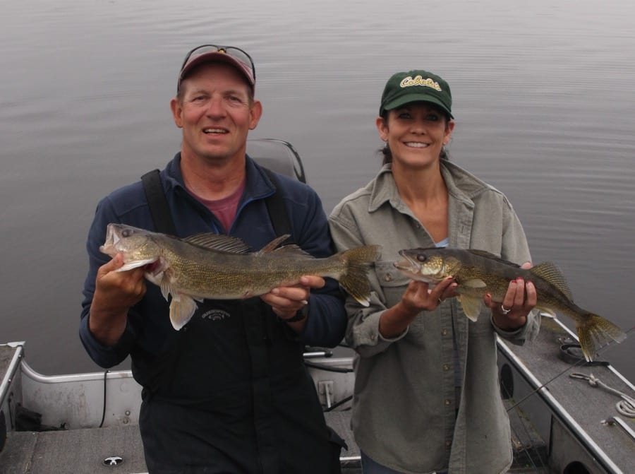 Man and Woman holding walleyes